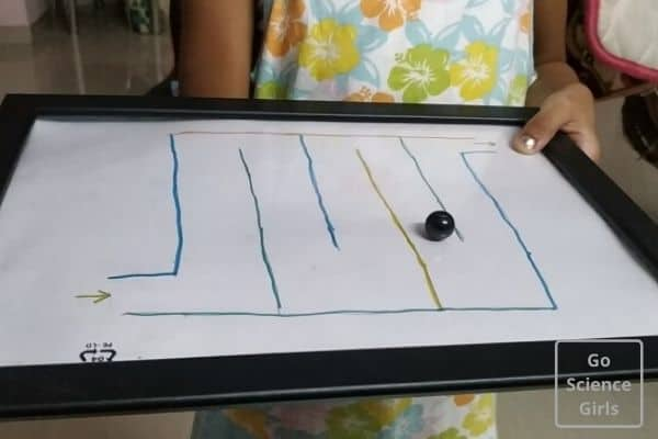 Playing with the DIY magnet maze game