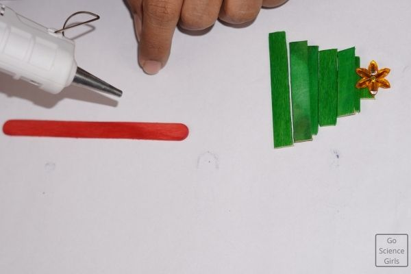 Paste Green Popsicle Sticks On The Red Stick