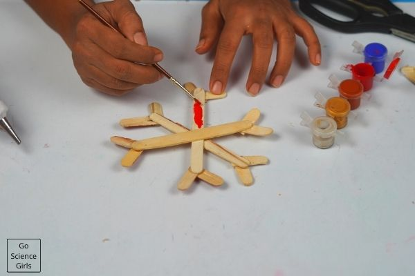 Painting Popsicle Stick Snowflakes Christmas Ornaments