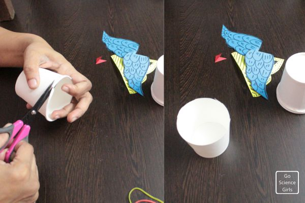 cut the edge of the paper cup to make base for rocket